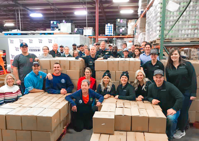 Spiros Law volunteers with the Eastern Illinois Foodbank